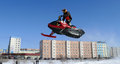Snow cross country race nadim russia april unknown athletes snowmobile on speed jump Royalty Free Stock Photos