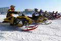 Snow cross country race nadim russia april unknown athletes at the start the beginning of the competition athletes snowmobile on Royalty Free Stock Images