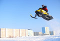 Snow cross country race russia nadim february snoukross vadim vasuhin in jump with springboard on snowmobile during Stock Photo