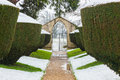 Snow fall on Yew hedges in formal, historic garden at Rousham House, Oxfordshire, England Royalty Free Stock Photo
