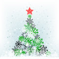 Snow feer tree with red star the color on the cerulean mesh background Royalty Free Stock Photo