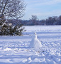 Snow field with snowman Royalty Free Stock Photo