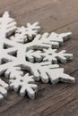 Snow flake shape on wooden table Stock Images