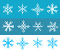 Snow flakes vector illustration in white and blue colors Royalty Free Stock Images