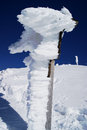 Snow formation atop mountain covered wooden post untersberg near salzburg austria Stock Image