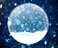 Snow globe on blue background with bokeh Royalty Free Stock Photo
