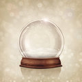 Snow globe on a golden background Stock Photos