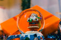 Snow globe with santa claus inside and Christmas gifts in the ba Royalty Free Stock Photo