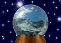 image photo : Snow globe with snow-covered mountain tops