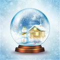 Snow globe snowman family in a Stock Image
