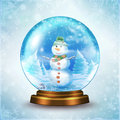 Snow globe snowman family in a Stock Photo