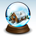 Snow globe with winter house landscape and pines on wood base eps Royalty Free Stock Photo
