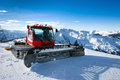 Snow grooming machine on snow hill ready for skiing slope preparations in austrian alps Royalty Free Stock Photography