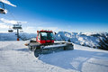 Snow grooming machine on snow hill ready for skiing slope preparations in austrian alps Stock Photo