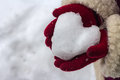 Snow heart in his hands of are holding close up Stock Images