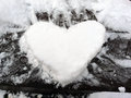Snow heart make a on a cold winter day with Royalty Free Stock Images