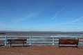 Snow on lake district hills across morecambe bay view from promenade near eric statue looking at low tide to grange over sands and Royalty Free Stock Photo