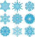 Snow it is a lot of snowflakes of a different form on a white background Royalty Free Stock Photo