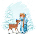 Snow Maiden in blue fur coat and fawn among pine trees in winter forest Royalty Free Stock Photo