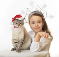 Snow Maiden with funny Santa Claus. Royalty Free Stock Photography