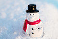 Snow man, snowman toy on snow background. Cristmas Royalty Free Stock Photo