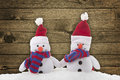 Snow man toy on a wood background Royalty Free Stock Photography