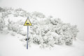 Snow mobile warning sign in winter time yellow danger and white snowy background Royalty Free Stock Photos