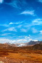 Snow mountains desert peaks of in the blue sky Royalty Free Stock Photography