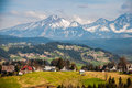 Snow in the mountains tatra on poland behind fields Stock Photography