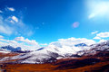 Snow moutain in tibet under the sun Royalty Free Stock Image