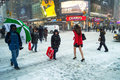Snow on nd st a lady in a short skirt and high heels crosses during the big storm january in manhattan Stock Image