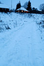 Snow pathway in country village Royalty Free Stock Photo
