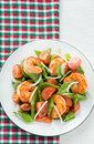 Snow peas and tomato salad with shrimps prawns vertical Stock Photo