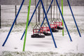 Snow in playground on swing seat a children s Royalty Free Stock Image