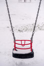 Snow in playground on swing seat a children s Stock Photos