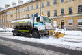 Snow plough clears street in bath uk united kingdom january a truck and spreads salt on a on th january Stock Photo