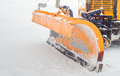 Snow plow doing removal after a blizzard in chicago suburb Royalty Free Stock Photography
