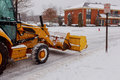Snow plow doing removal after a blizzard