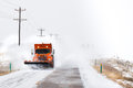 Snow plow removing snow from road