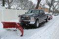 Snow plow truck in Brooklyn, NY ready to clean streets after massive Winter Storm Helen strikes Northeast Royalty Free Stock Photo
