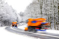 Snow plow on winter road vehicles blurred two plows working Stock Photography