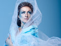 Snow queen attractive young girl with a theatrical makeup on the face in the image fabulous Stock Photo