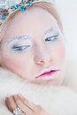 Snow queen beauty make up young blonde girl like with extreme makeup Royalty Free Stock Photo
