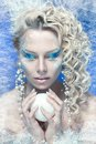 Snow queen ce young woman in creative image with silver blue artistic make up and perfect hairstyle Royalty Free Stock Photography