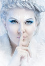 Snow queen with a finger over mouth Royalty Free Stock Images