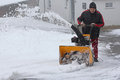 Snow removal in heavy Royalty Free Stock Photo