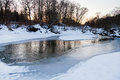 Snow riverbank of forest stream in winter Royalty Free Stock Photography