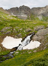 Snow runoff melting a stream. Royalty Free Stock Image