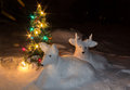 Snow sculptures with christmas tree Stock Photos