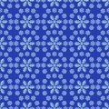 Snow seamless pattern with snowflakes on dark blue background Royalty Free Stock Image